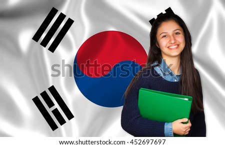 Teen student smiling over Korean flag. Concept of lessons and learning of foreign languages.