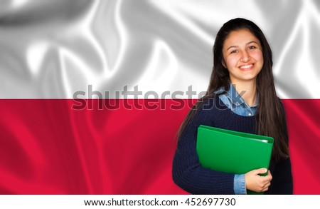 Teen student smiling over Polish flag. Concept of lessons and learning of foreign languages.