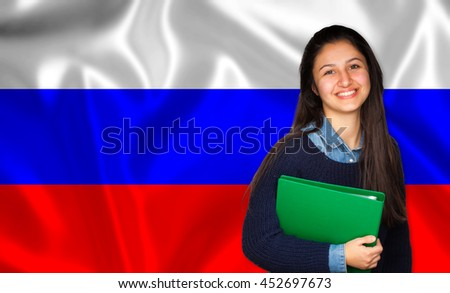 Teen student smiling over russian flag. Concept of lessons and learning of foreign languages.