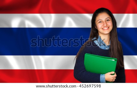 Teen student smiling over Thai flag. Concept of lessons and learning of foreign languages.