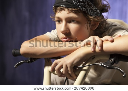 Teen thinking about life on the background wall of the city - stock photo