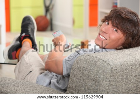 teen watching tv - stock photo