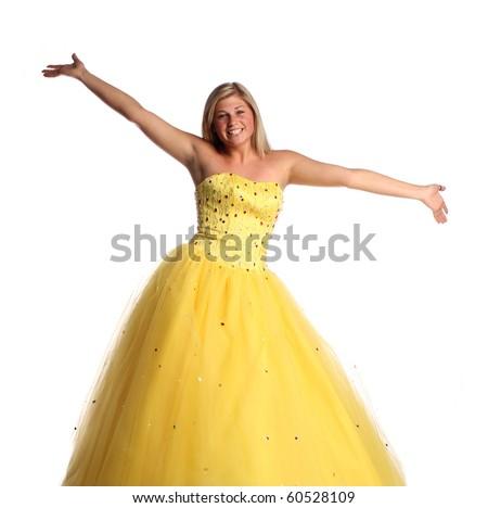 Teen wearing yellow prom dress - stock photo