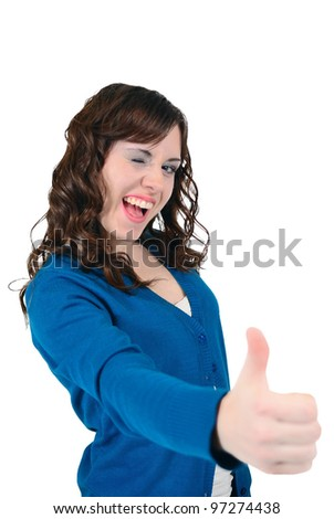 Teen winks and shows thumb-up - stock photo
