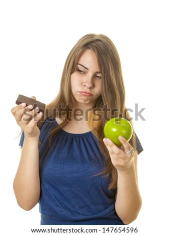 Teen with brownie and apple against a white background.