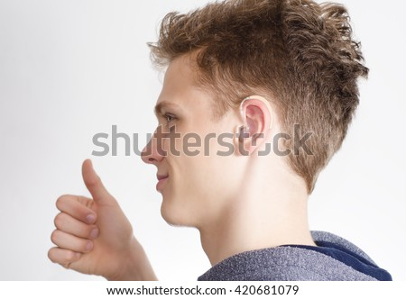 Teen Hearing Aid Showing Thumb Up Stock Photo Royalty