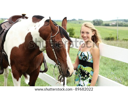 Teen with her horse - stock photo