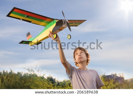 Teen with homemade radio-controlled model aircraft - stock photo