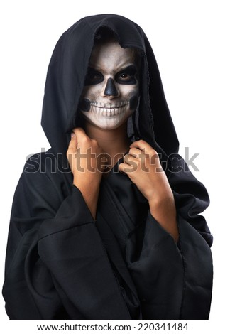 Teen with make-up of the skull in a black cloak laughs