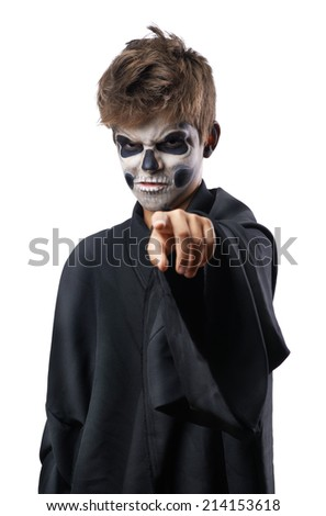 Teen with makeup skull cape points finger