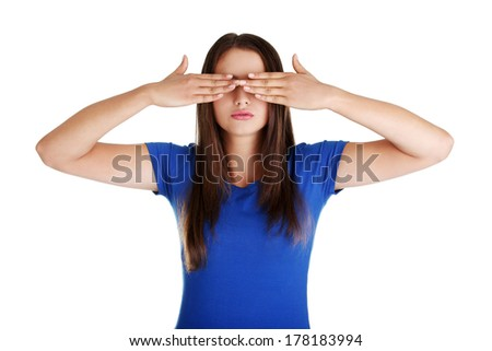 Teen woman covering her eyes isolated on white background  - stock photo