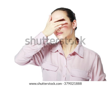 Teen woman covering her eyes isolated on white background