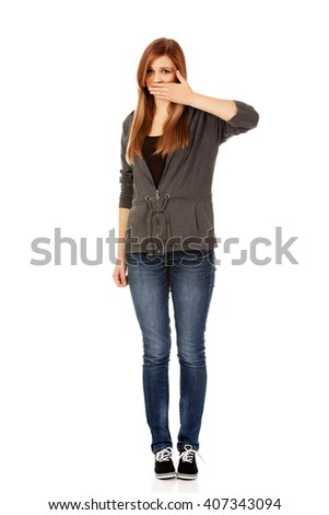 Teen woman covering her mouth with hand - stock photo