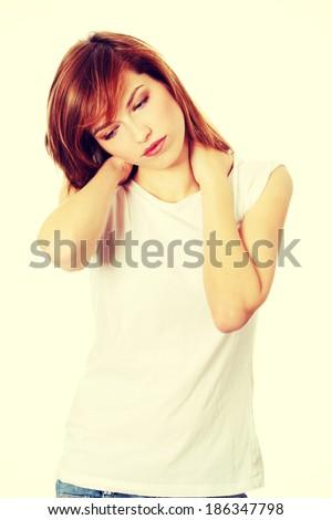 Teen woman heaving neck pain, isolated on white - stock photo