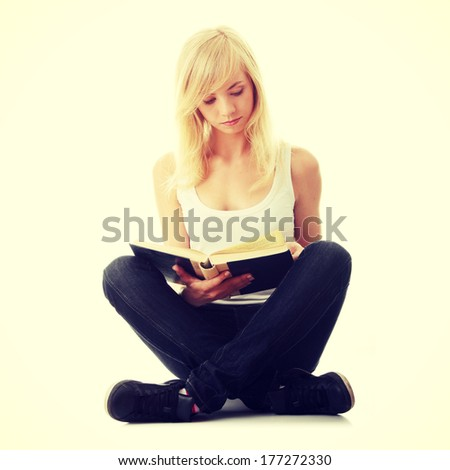 Teen woman reading book , isolated on white background  - stock photo