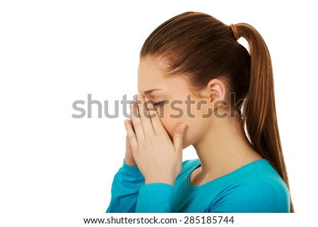 Teen woman suffering from sinus pressure pain. - stock photo
