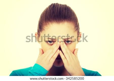 Teen woman suffering from sinus pressure pain. - stock photo