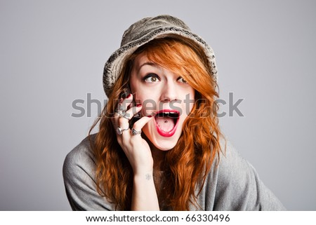 teen woman talking on cellphone, making happy surprice face, studio shot - stock photo