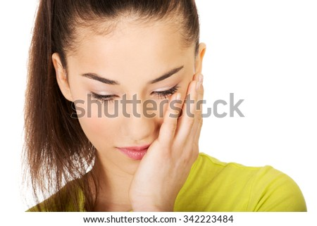 Teen woman with a toothache touching face. - stock photo