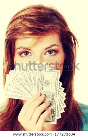 Teen woman with dollars. Isolated on white  - stock photo