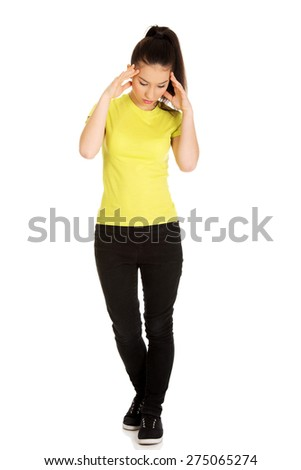Teen woman with headache holding her hand to the head. - stock photo