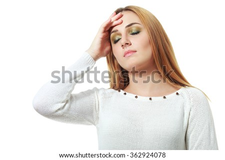 Teen woman with headache holding her hand to the head, isolated on white