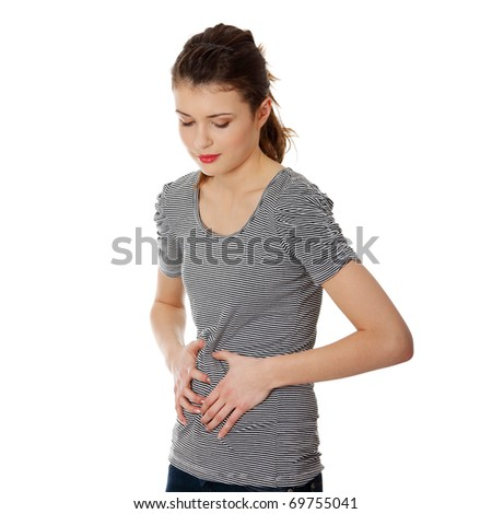 Teen woman with stomach issues,isolated on white - stock photo