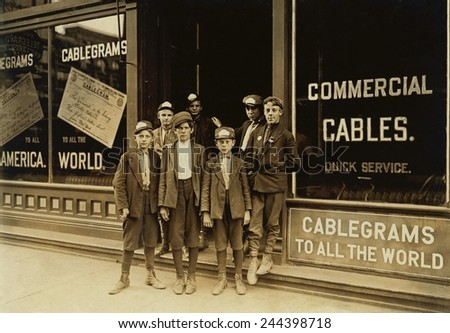 Teenage and child Telegraph messengers, completed final leg of long distance communication by delivering the physical paper telegraphs. Child laborers photographed by Lewis Hine, Indianapolis, 1908. - stock photo