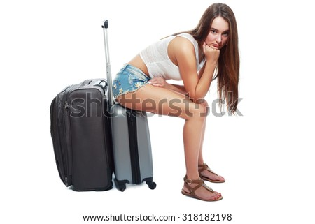 teenage and transportation concept - sad teen girl with suitcase, sad because her leaving home - stock photo