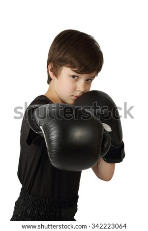 Teenage Asian boy in boxing gloves with harsh facial expression isolated on white background - stock photo