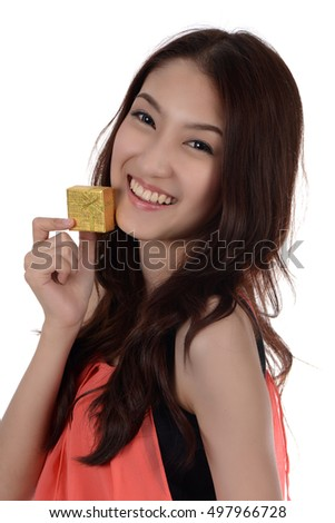 Teenage Asian woman happy with special gift box