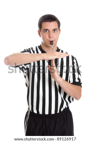 Teenage basketball referee giving sign for technical foul - stock photo