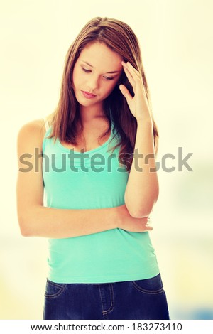 Teenage beautiful woman with depression - stock photo