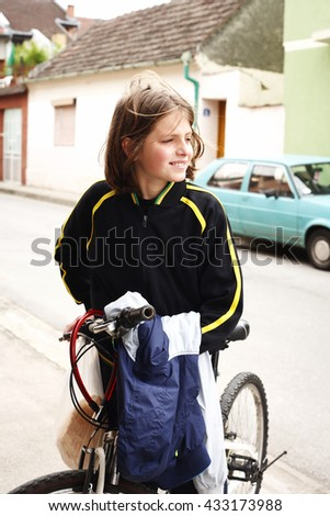 teenage boy and bike in city - stock photo