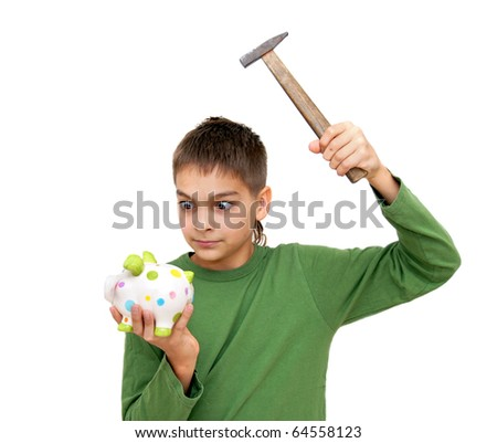 teenage boy breaking piggy money box isolated on white