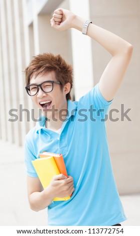 Teenage boy expressing his joy - stock photo