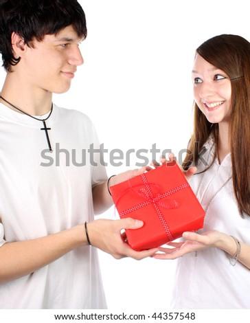 Teenage boy giving gift to teenage girl - stock photo
