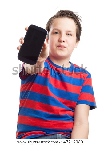 Teenage boy holding his mobile or smart phone into the camera - stock photo