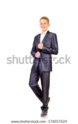 teenage boy in suit isolated on a white background - stock photo