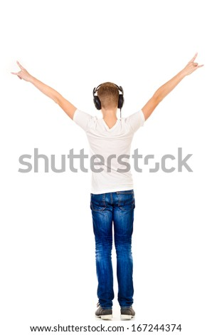 teenage boy listen music isolated on a white background - stock photo
