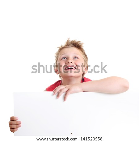 Teenage boy looking up beside a white blank. - stock photo