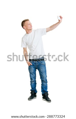 Teenage boy making a selfie isolated on white - stock photo