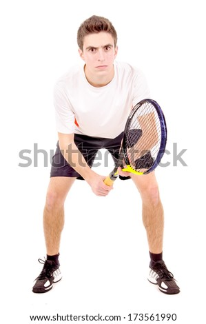 teenage boy playing tennis isolated in white - stock photo