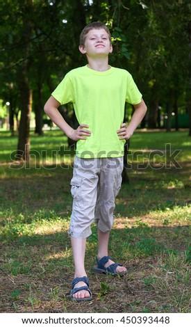 teenage boy portrait like a Superman posing on outdoor, summer season - stock photo