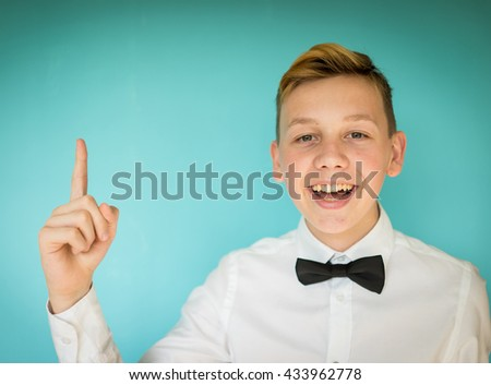 Teenage boy portrait on colorful background wall - stock photo