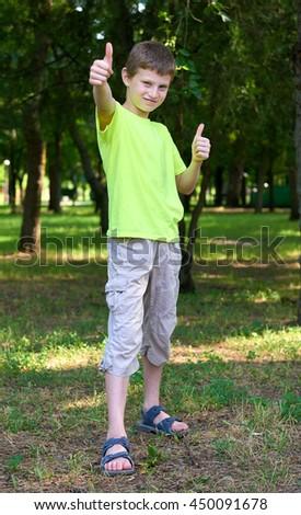 teenage boy portrait show best gesture on outdoor, summer season - stock photo
