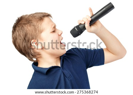 Teenage boy singing into a microphone on a white background. Very emotional. - stock photo