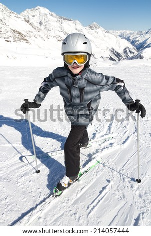 Teenage boy skier in high mountains - stock photo