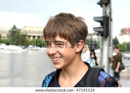 teenage boy stand on the street - stock photo