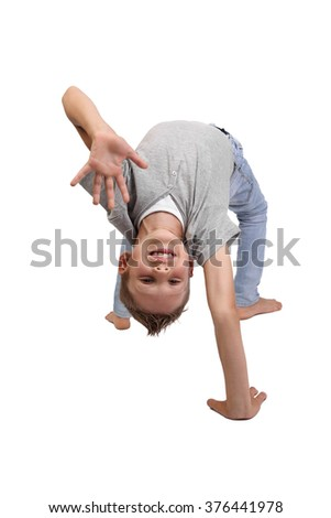 Teenage boy standing in a gymnastic bridge pose with a welcome gesture and smiling face isolated on white background - stock photo